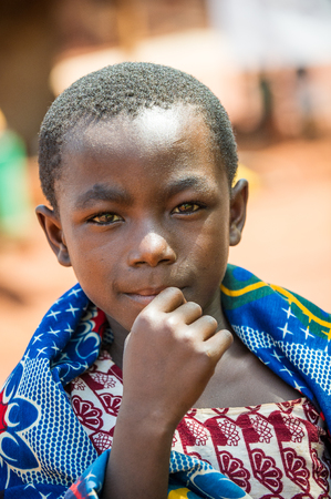 ACCRA, GHANA - MARCH 5, 2012: Unidentified Ghanaian boy in the street in Ghana. Children of Ghana suffer of poverty due to the unstable economic situation 報道画像