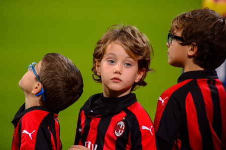 MILAN - NOV 11, 2018: Little boys. AC Milan - Juventus. Italian Serie A TIM. Giuseppe Meazza Stadium