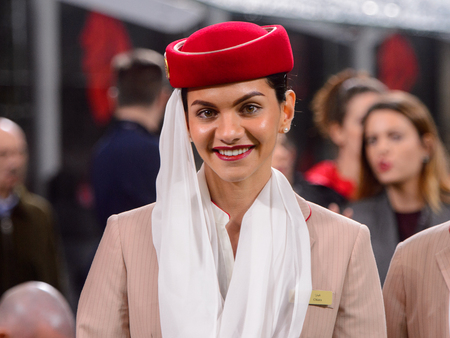 MILAN - NOV 11, 2018: Emirates stewardess before the match. AC Milan - Juventus. Italian Serie A TIM. Giuseppe Meazza Stadium Reklamní fotografie - 121150255