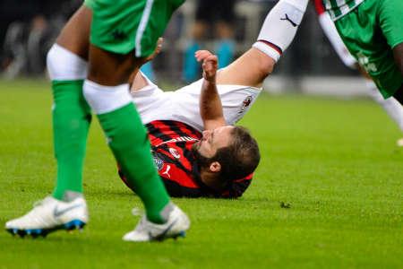 MILAN - OCT 25, 2018: Gonzalo Higuain 9 on the grass. AC Milan - Betis. UEFA Europe League. Giuseppe Meazza stadium.