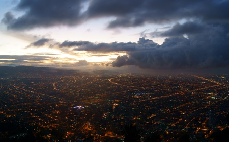 The city of Bogota, Colombia at dusk taken from the heights of Monserrate.  A storm is moving in from the Northwest photo
