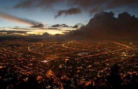 The city of Bogota, Colombia at night taken from the heights of Monserrate.  A storm is moving in from the Northwest