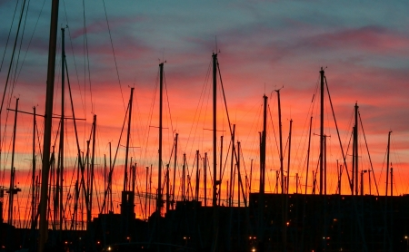 Masts against a Red Sky in the Old Habor in Marseille, France photo