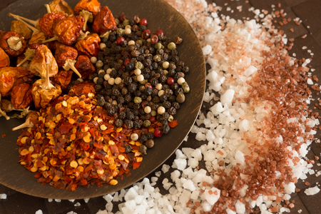 Kitchen still life with salt, pepper and spices photo