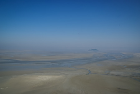 mont saint michel: Landscape in pastel colors, quick sands, Mont Saint Michel, France