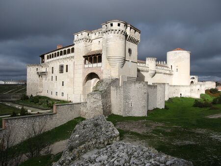 Image of white castle with  stormy clouds, Cuellar, Spain
