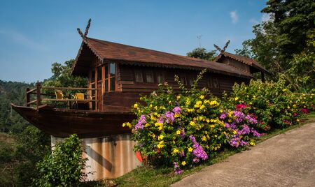 asian house plants: Image of a Little wooden house and a lot of multicolored flowers in the Land of smiles, Samui, Thailand