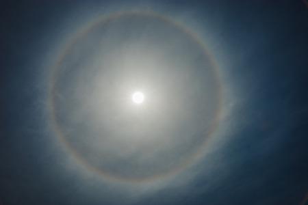 atmospheric phenomena: Rainbow around the sun through the clouds Stock Photo