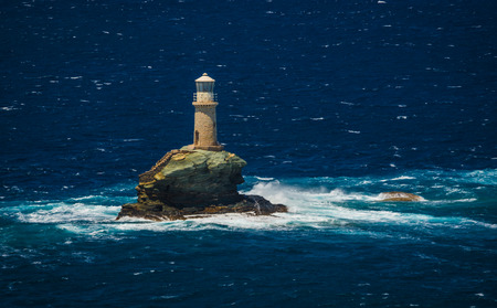 andros: Scenic view to lighthouse near the city of Andros, Andros, Greece