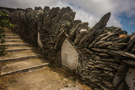 andros: Image of fence made of masonry and a staircase on the island of Andros, Greece Stock Photo
