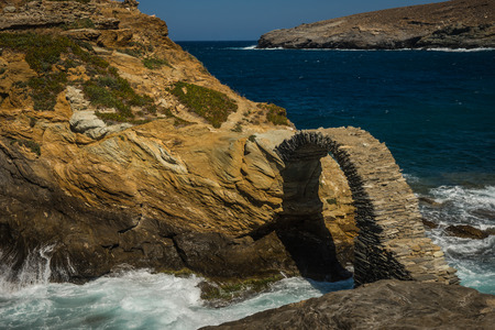 andros: Scenic view to ancient bridge to small island near the town of Andros, Andros, Greece Stock Photo