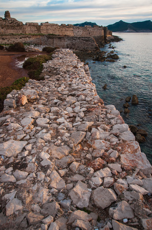 waterside: Image of seascape and ruins of fortress of Methoni, Peloponnese, Greece Stock Photo
