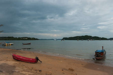 brige: Image of Long-tail boat on the beach and brige, Phuket, Thailand
