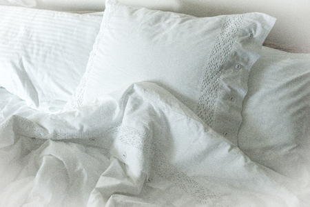 white pillow: Image of White embroidered linens, pillows and blankets Stock Photo