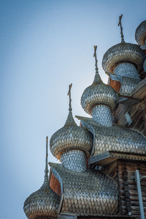 karelia: Image of Carved wooden domes  in Kizhi, Karelia, many midges