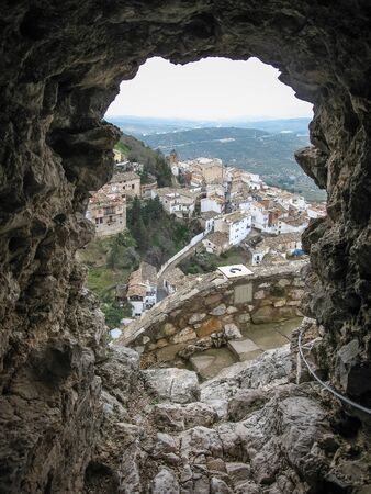 embrasure: Scenic View of the white city through an embrasure of the ancient castle, La Iruela, Andalusia, Spain Stock Photo