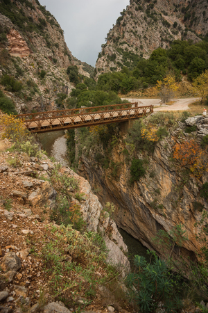 karpenisi: Scenic mountain autumn landscape with river and bridge, Evitania, Greece