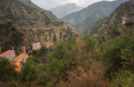 karpenisi: Scenic mountain autumn landscape with a monastery, Evitania, Greece Stock Photo