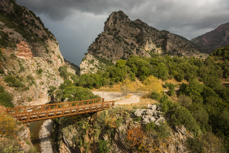 scenic landscapes: Scenic mountain autumn landscape with river and bridge, Evitania, Greece