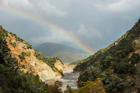 karpenisi: Scenic view from the mountain to the river and rainbow, Evritania, Greece Stock Photo