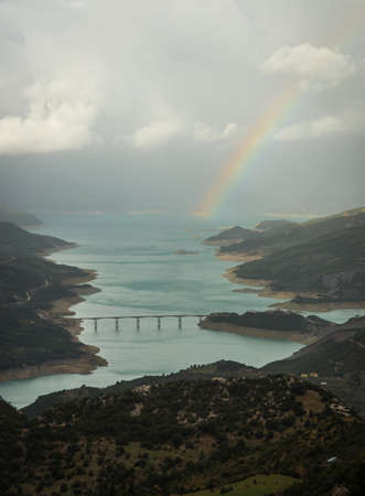 karpenisi: Scenic view from the mountain to the lake and rainbow, Evitania, Greece