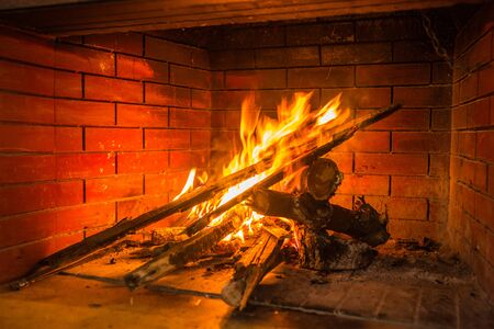 fire brick: Fire burning in  red brick fireplace, Greece Stock Photo