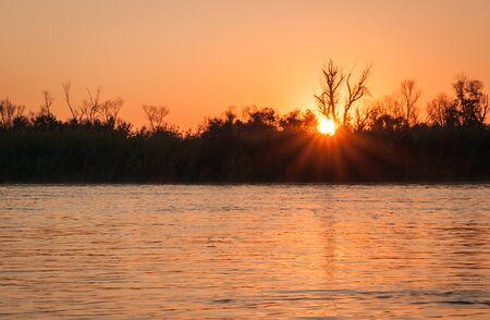 volga: Landscape with a river at sunset at Volga Delta, Russia