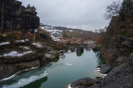 rare rocks: Image of river with green waters, snow and ice near Meteora in Greece Stock Photo