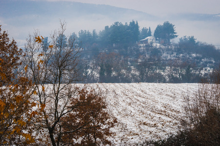 Beautiful landscape with small house on  hill, snow and fog near Edessa, Greece Banco de Imagens