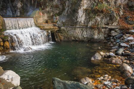 River with colored stones and hot springs in Loutra Pozar in Northern Greece Banco de Imagens