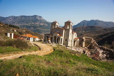 landslip: Image of sliding village Ropoto and church after a landslide in Greece Stock Photo