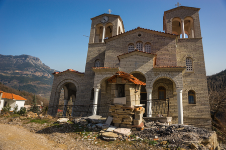 skewed: Image of sliding village Ropoto and church after a landslide in Greece Stock Photo