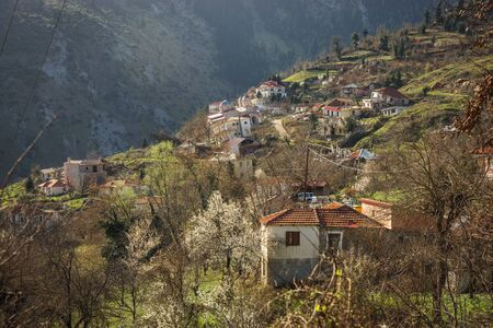 landfall: Image of sliding village Ropoto and church after a landslide in Greece Stock Photo