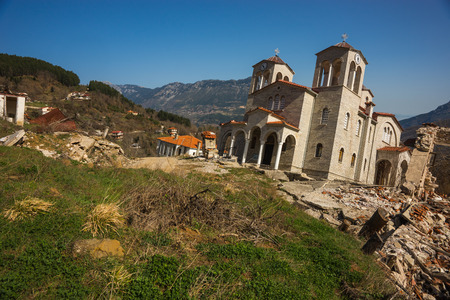 country church: Image of sliding village Ropoto and church after a landslide in Greece Stock Photo