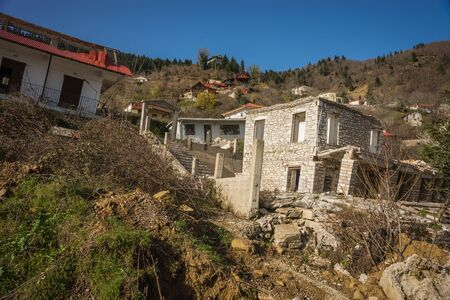 landslip: Image of sliding village Ropoto after a landslide in Greece Stock Photo
