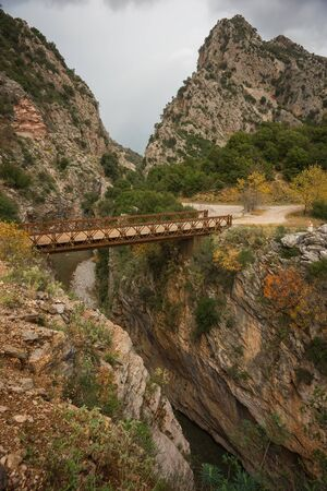 karpenisi: Scenic mountain autumn landscape with river and bridge, Evritania, Greece