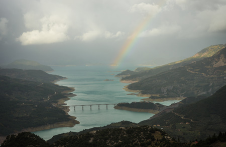 karpenisi: Scenic view from the mountain to the lake and rainbow, Evritania, Greece
