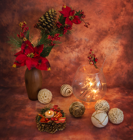 colores calidos: Christmas still life with sparklers and ornaments in warm colors