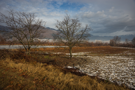 Beautiful landscape with snow-covered fields and fog in the mountains near Edessa, Greece