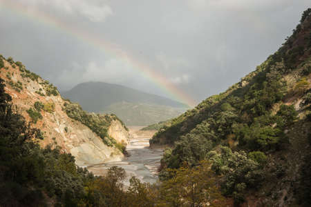 karpenisi: Scenic view from the mountain to the river and rainbow, Evrritania, Greece Stock Photo