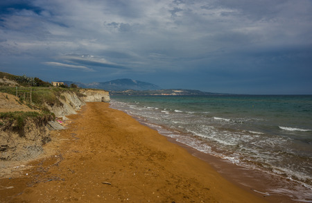 Stunning red sand and white rocks on Ksi beach on Kefalonia in Greece