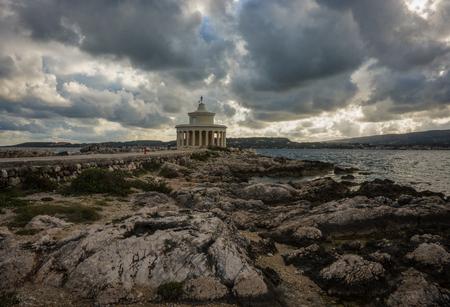 Lighthouse of Saint Theodore on a cape near Argostoli in Kefalonia, Greece Stock Photo