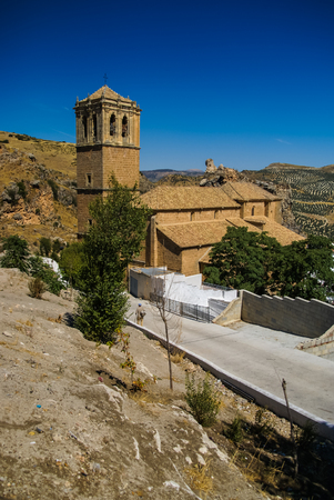 Scenic view to the church in Colomera in Spain