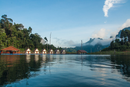 Scenic and unique landscape with floating houses at Chieou Laan lake in Thailand Stock Photo