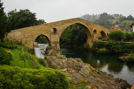 Image of Old Roman stone bridge in Cangas de Onis in Asturias, Spain Stock Photo