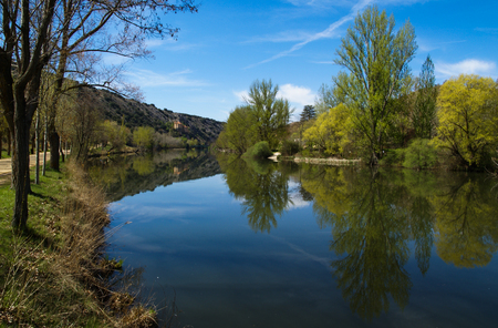 Beautiful landscape with river Duero and reflections in water in Soria, Castilla y Leon, Spain Stock Photo