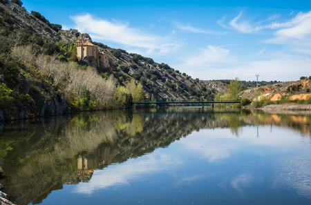 Beautiful landscape with river Duero, St. Saturio chirch and reflections in water in Soria, Castilla y Leon, Spain Stock Photo