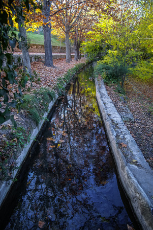 Autumn landscape with colorful leaves, river and reflections in water in Caravaca de la Crus, Spain Stock Photo