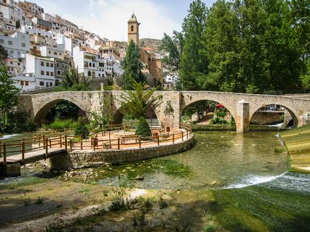 mancha: Cityscape with bridge over river at Alcala del Jucar in Castilla la Mancha, Spain Stock Photo