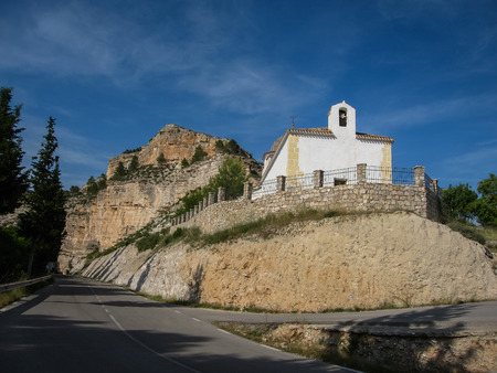 castilla: White church near the road at Alcala del Jucar in Castilla la Manca, Spain